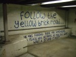 'follow the yellow brick road...' had appeared on the walls along with 'he was fighting some war somewhere, a place with no name, he died. She wept. What a stupid concept.'