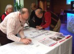 Peter Nowland, Conference Organiser, helping get the reception table ready