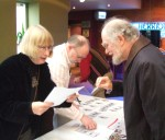 Pam Shackleton registering Rod Tickner from the Aire Valley Rail Users Group