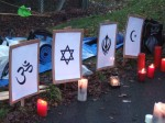 A variety of affiity groups took responsibility for different gates, there being a total 9 gates to Aldermaston Weapons Establishment (AWE). Tadley Gate was primarily for faith groups. Here a variety of candles & symbols on the ground representing different faiths