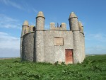 Harald's Tower (1790), a sham mausolem, built for Sir John Sinclair to bolster his ancestral claims of descent from Harald the Earl of Caithness who was killed here at the end of the 12th Century