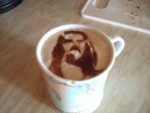 John sprinkled some chocolate on his hot drink and it made the face of Jesus!