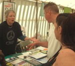here Joan discussing the issues with a couple of visitors to the stall