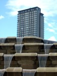 flats towering over the waterfalls