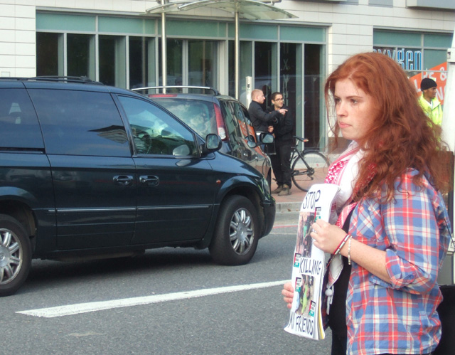 Once again on Thursday, the last day of DSEi, a dinner was held for the Arms Dealers. Here, a demonstrator with her placard entitled 'Stop Killing My Friends' pointed at the luxury cars passing by.