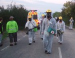 when out of the dawn came a group in white contamination suits