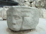 a grumpy face in a carving work area in the quarry