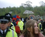 A mingled throng of people locked on or sat down, others supporting, street theatre and the police who were very well behaved aapart from not letting us get off our coaches and sending us up and down the road several times before we could make a break for it