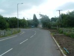 52. looking east on the road to Earby industrial estate which has been built across the railway trackbed