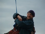 dangling on a rope - one of the intrepid climbers - more of the climbers further on