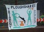ploughshares banner on the North gate to the Faslane Nuclear submarine base