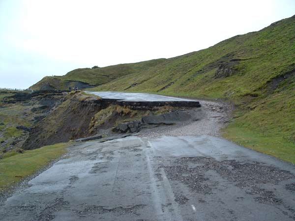 a gap near the top where the tarmac has slid away
