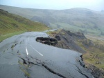 If you think the pot holes in your street are bad, then take a look at the old A road that skirts Mam Tor in Derbyshire. Mended many times, it was finally abandoned about 20 years ago. Now the only traffic is walkers and cyclists. This photo shows that the edge of the mountain is sliding and taking the road with it