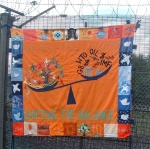 A carefully crafted beautiful banner on the banner on the fence by the North gate