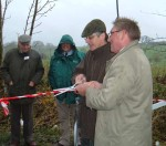 the two MP's cutting the ribbon marking the border, sybolic of reuniting the link between Yorkshire and Lancashire