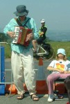 an accordionist outside the base keeping us cheery