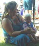 Kerris & Aelwyn keeping cool in the tent kindly provided