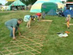 putting up the Home Education yurt - lifting up the side framework