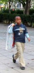 here a cheerful chappie carrying home his shopping