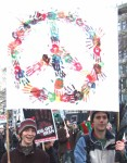Tens of thousands marched through the streets of London to encourage MPs to say NO to the spending of £25 to £75 billion on the renewal of Britain's nuclear submarine fleet with its hideous weapons of mass destruction. here, a colourful CND peace sign made up of handprints
