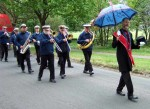 the band marching up to the Festival site in front of Townley hall