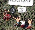 some splendid protest by action men outside the Faslane Peace Camp area