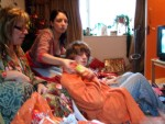 christmas day was at alison's this year - here, bubs passing presents out