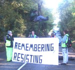 The aim of the day was to disrupt the work of AWE Aldermaston where scientists are, illegally and without approval by Parliament, developing a new generation of warheads for Trident Nuclear missiles. Hundreds of activists descended on Berkshire and used non violent direct action to block the base. Here one is on a tripod blocking the road to the Home Office Gate, a gate which had been blocked for several hours by a previous action. Needless to say any disruption to local traffic which may have been caused is infinitesimally insignificant to the chaos that would be caused by such a warhead exploding whether deliberately or by accident.