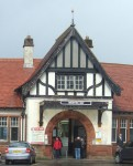 the entrance to the station with it's mock tudor facade in need of repainting